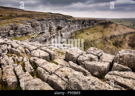 Limestone karst at Malham Cove, Yorkshire Dales, North Yorkshire, England, formed by a waterfall... - Stock Photo