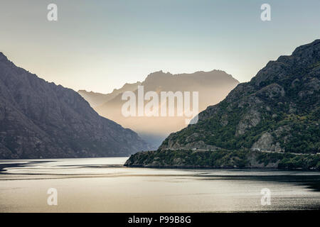 View looking north on the Kingston Arm of Lake Wakatipu, near Queenstown, New Zealand as sunset approaches. - Stock Photo