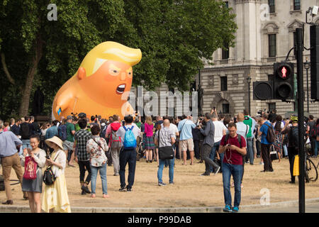 'STOP TRUMP' protest march in Parliament Square Gardens as an angry  caricature of President Donald Trump faces the crowd. London, UK 13/7/18. - Stock Photo