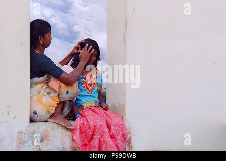 Mother checking for head lice at daughter in the morning - Stock Photo