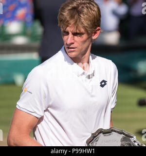 Kevin Anderson, South African player, holding his plate on centre court as runner up in the Wimbledon mens finals - Stock Photo