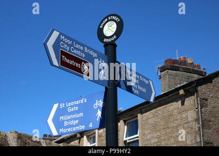 Signpost by Shaw Street bridge over Lancaster Canal in Freehold area of Lancaster, showing the direction and distance along footpaths and cycle paths. - Stock Photo