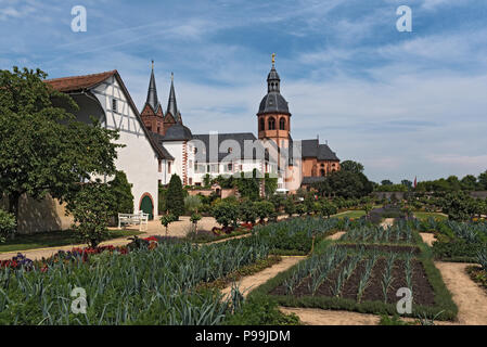 Ancient monastery Seligenstadt, historic baroque building Basilika Saint Marcellinus and Petrus. - Stock Photo