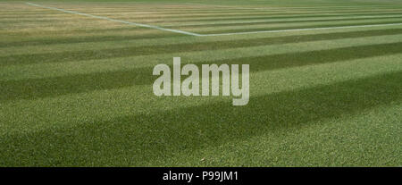 Close up of well manicured grass tennis court at Wimbledon, photographed during the 2018 championships. - Stock Photo