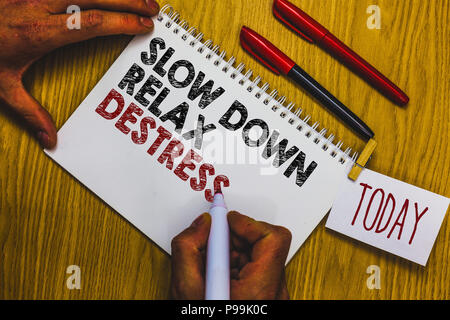 Writing note showing Slow Down Relax Destress. Business photo showcasing calming bring happiness and put you in good mood Man holding marker notebook  - Stock Photo