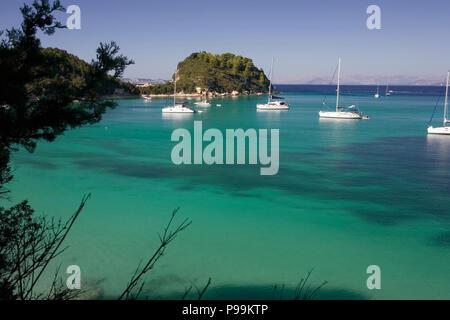 The beautiful bay at Lakka, Paxos, Greece, with yachts at anchor - Stock Photo