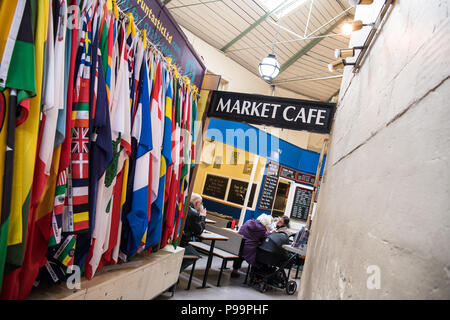 A wall full of international flags hanging from a stall at The Guildhall Market near the cate in UNESCO World Heritage site Bath, UK - Stock Photo