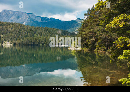 Looking out over the crystal clear waters of Crno Jezero (Black Lake) in Durmitor National Park, Montenegro - Stock Photo