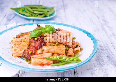 Pasta with fresh green peas. Traditional food. Oriental dishes. White wooden background. Healthy food. Diet. Free space for text. - Stock Photo