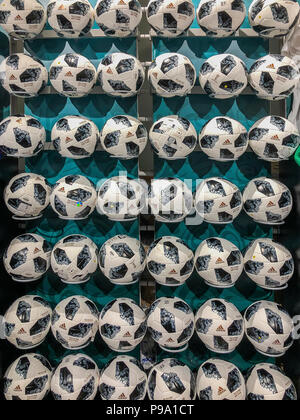 MOSCOW, RUSSIA - JULY, 10, 2018: Soccer balls with logo on wall, World Cup FIFA 2018, FIFA Fan Fest in the official mundial souvenir shop - Stock Photo