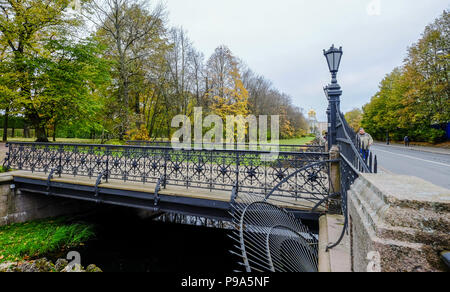 St Petersburg, Russia - Oct 7, 2016. Decorations of ancient bridge at autumn garden in Saint Petersburg, Russia. - Stock Photo
