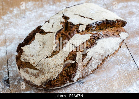 artisan healthy organic traditional cracked sourdough rye bread - Stock Photo