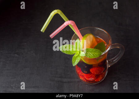 Cocktail with black currant, strawberry, mint and lime. Cooling summer drink - Stock Photo