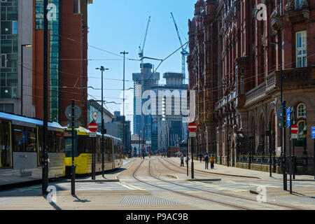 The Axis and Deansgate Square apartment blocks (under construction) with a Metrolink tram passing the Midland Hotel, Lower Mosley St., Manchester, UK - Stock Photo