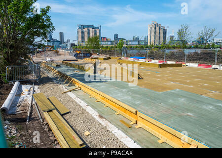 Timber concreting formwork for a set of points on the Metrolink Trafford Park tram line, under construction at Trafford Wharf, Manchester, England, UK - Stock Photo