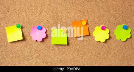 School concept. Six sticky notes in various shapes with pushpins and blank space, isolated on cork background. - Stock Photo