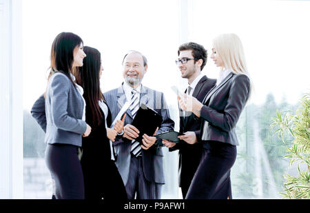 business team with documents standing in the modern office. - Stock Photo