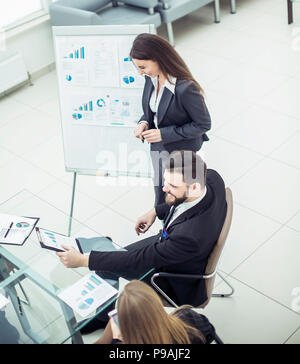 members of a business team discussing the presentation of a new financial project. - Stock Photo