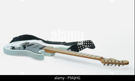 close-up of soft fabric and a black and white electric guitar.isolated on a white background.photo with copy space Stock Photo