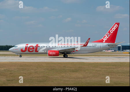 An Jet2 Boeing 737-85P sits on the runway at Manchester Airport as it prepares to take-off. - Stock Photo