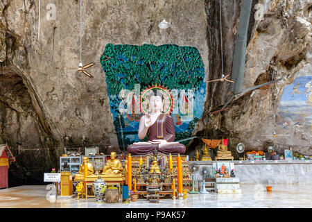 KRABI, THAILAND - APRIL 10: Buddha images in the Tiger Cave Temple on April 10, 2016 in Krabi, Thailand. - Stock Photo