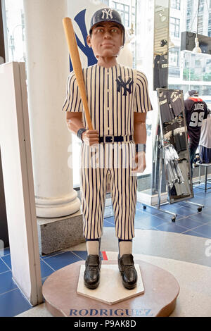 A tall bobble head doll of Alex Rodriguez displayed in the New York Yankees team store on Fifth Avenue in Manhattan, New York City. - Stock Photo