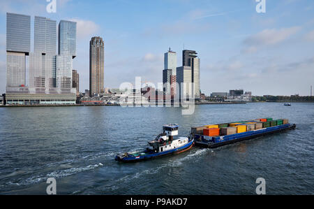 Freight transport in containers by ship on the river the Nieuwe Maas in Rotterdam, Netherlands. - Stock Photo