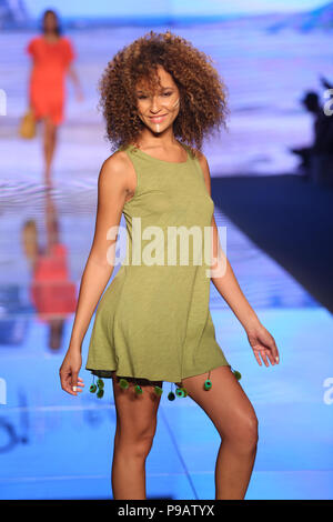 MIAMI BEACH, FL - JULY 15: A model walks the runway for Pitusa Swim show during the Paraiso Fasion Fair at The Paraiso Tent on July 15, 2018 in Miami Beach, Florida  People:  Model - Stock Photo
