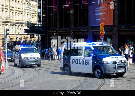 Helsinki, Finland. July 16, 2018. Police officers and vehicles in central Helsinki on the day of the US and Russian Presidents' historic Helsinki2018 meeting. Credit: Taina Sohlman/Alamy Live News - Stock Photo