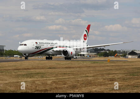 Farnborough, UK. 16th July 2018. A Boeing 787-800 of Bangladesh Airlines Biman takes off to perform its display on the opening day of the 2018 Farnborough International Airshow, one of the biggest aviation trade and industry events in the world, held in the UK. Credit: James Hancock/Alamy Live News - Stock Photo