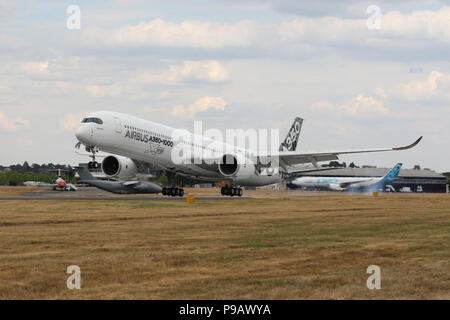Farnborough, UK. 16th July 2018. An Airbus A350-100 XWB lands after performing its display on the opening day of the 2018 Farnborough International Airshow, one of the biggest aviation trade and industry events in the world, held in the UK. Credit: James Hancock/Alamy Live News - Stock Photo