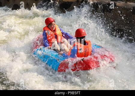 Huai'an, China's Jiangsu Province. 17th July, 2018. Tourists experience drifting at an amusement park in Heqiao Township of Xuyi, east China's Jiangsu Province, July 17, 2018. Credit: Zhou Haijun/Xinhua/Alamy Live News - Stock Photo