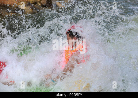 Huai'an, China's Jiangsu Province. 17th July, 2018. A tourist experiences drifting at an amusement park in Heqiao Township of Xuyi, east China's Jiangsu Province, July 17, 2018. Credit: Zhou Haijun/Xinhua/Alamy Live News - Stock Photo