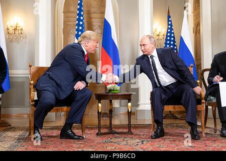 Russian President Vladimir Putin shakes hands with U.S. President Donald Trump during the U.S. - Russia Summit meeting at the Presidential Palace July 16, 2018 in Helsinki, Finland. - Stock Photo