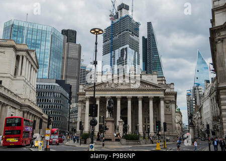 London, UK. 17th July 2018. New mammoth skyscrapers continue to rise up and dominate the traditional buildings of the Bank of England and the Royal Exchange in the City of London. Credit: Guy Bell/Alamy Live News - Stock Photo