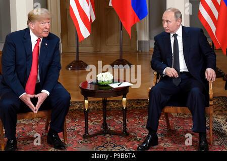 Beijing, Finland. 16th July, 2018. U.S. President Donald Trump (L) meets with his Russian counterpart Vladimir Putin in Helsinki, Finland, on July 16, 2018. Credit: Lehtikuva/Heikki Saukkomaa/Xinhua/Alamy Live News - Stock Photo
