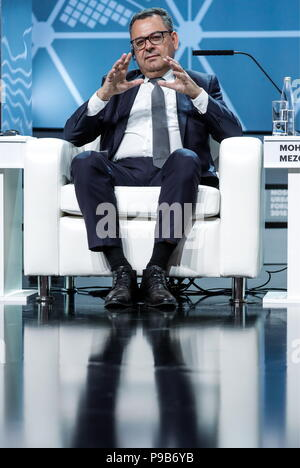 Moscow, Russia. 17th July, 2018. MOSCOW, RUSSIA - JULY 17, 2018: Mohamed Mezghani, Secretary General of the International Association of Public Transport (UITP), attends a briefing titled 'City of Megaprojects - From Results to New Goals' as part of the 2018 Moscow Urban Forum in Moscow's Zaryadye Park. Mikhail Japaridze/TASS Credit: ITAR-TASS News Agency/Alamy Live News - Stock Photo