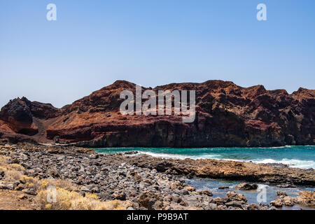 The volcanic rock on the one hand and the roaring Atlantic Ocean with its play of colors on the other hand inspire and let time forget within seconds. - Stock Photo