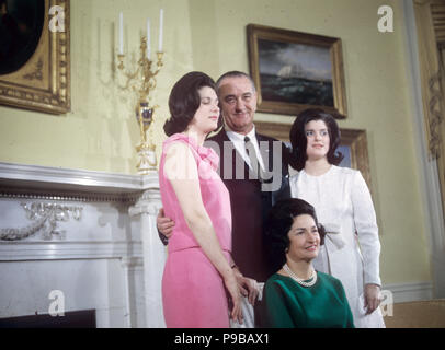 LYNDON B. JOHNSON (1908-1973) as 36th President of the United States with his wife Lady Bird and daughters Luci at left and Lyn about 1964 - Stock Photo