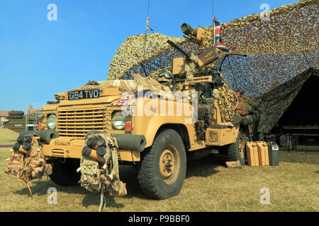 British, 1980s, Military Vehicle, Jeep, vintage, British Army, camouflage netting, tent, as served in Afghanistan War - Stock Photo