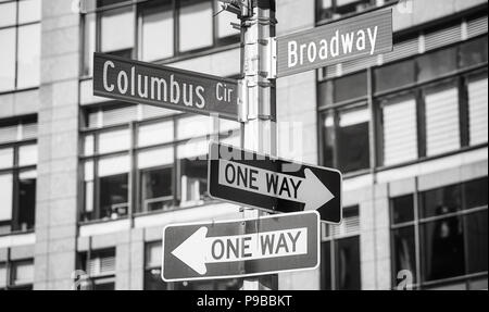 Black and white picture of Broadway and Columbus Circle street name signs, New York City, USA. - Stock Photo
