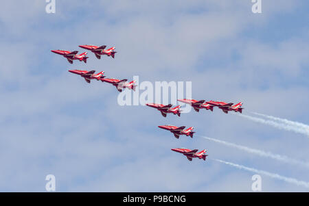 All nine Hawk jets of the Royal Air Force aerobatic team, the Red Arrows, flying in formation at the Royal International Air Tattoo 2018 - Stock Photo