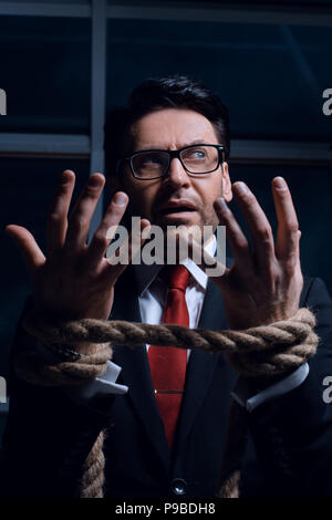 close up.screaming businessman with his hands tied - Stock Photo