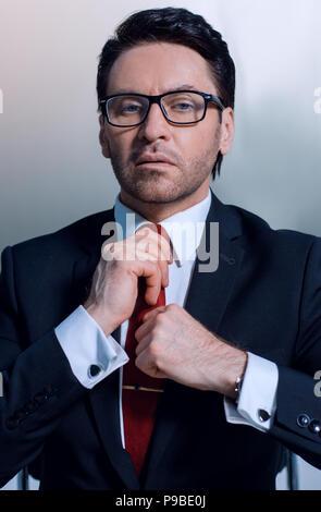 close up.businessman adjusting his tie - Stock Photo