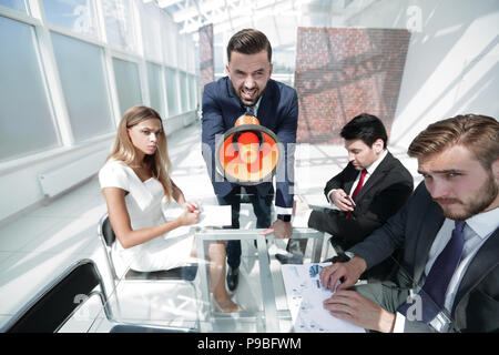 angry boss with megaphone at work meeting - Stock Photo