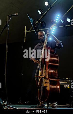 Kevin Hamilton playing upright bass with Ranky Tanky, Vancouver Folk Music Festival, Vancouver, British Columbia, Canada. - Stock Photo