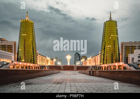 Night view over Astana in Kazakhstan with Golden Towers aka the Beer Cans and Bayterek Tower - Stock Photo