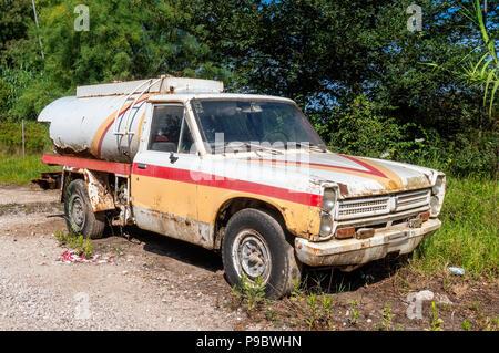 Old Nissan Junior Pickup rebuilt as Shell tank wagon - Stock Photo
