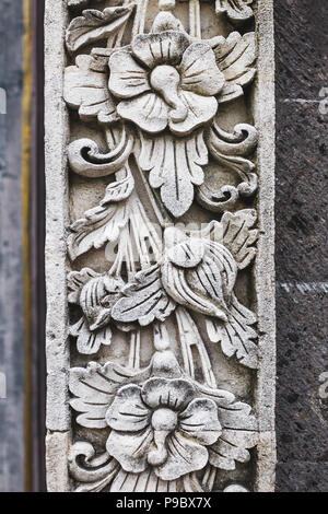 Traditional balinese stone carving, wall in temple - Stock Photo