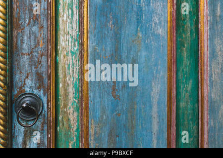 Wooden painted shabby texture of door with metal knob - Stock Photo